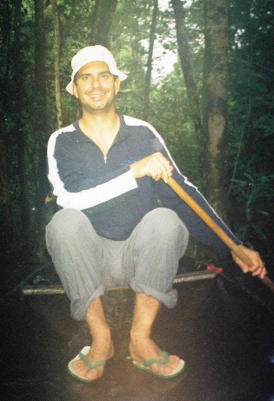 Paddling a dugout canoe in the Amazon rainforest