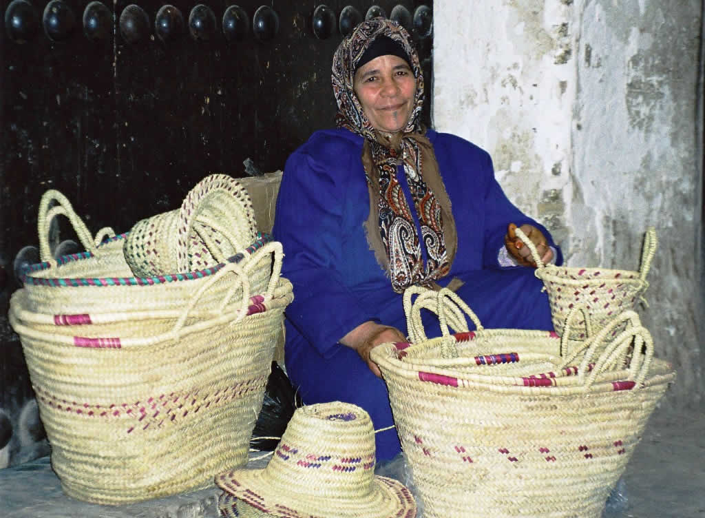 Weaving vendor sells baskets and hats in Fes, Morocco