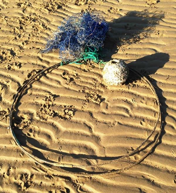Ghost fishing net on beach near Townsville, Australia