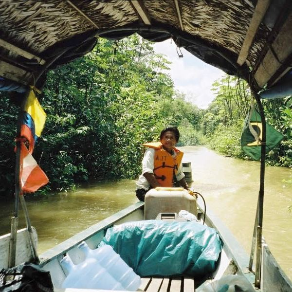 Riverboats ply the Javari River at the tri-border area of Colombia, Peru and Brazil