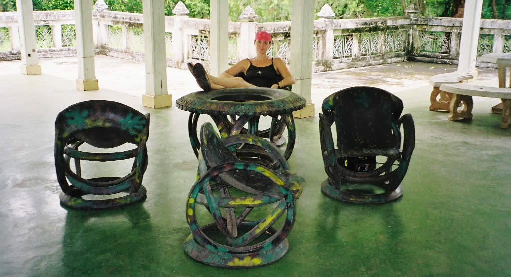 Diane relaxes on furniture made from old tires near Phitsanoluk, Thailand