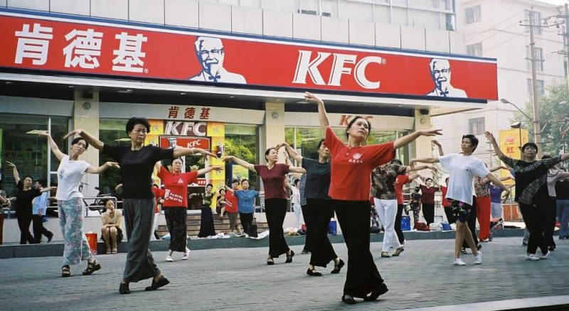 Tai Chi practice in Yichang, China outside a KFC