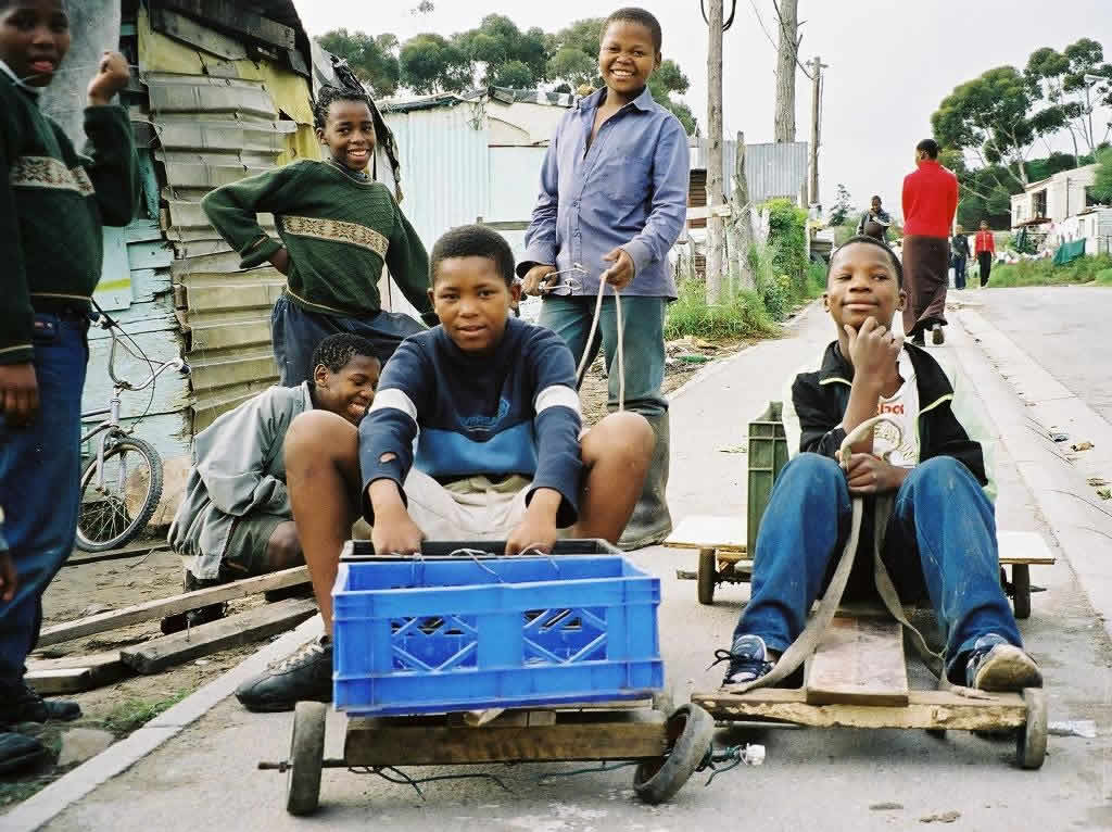 Local children race wooden go-karts at Imizamo Yethu Township near Cape Town, South Africa