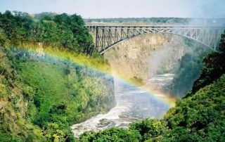 Victoria Falls rainbow over the Zambezi River between Zambia and Zimbabwe